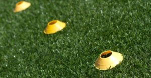 Close up of soccer cones on field